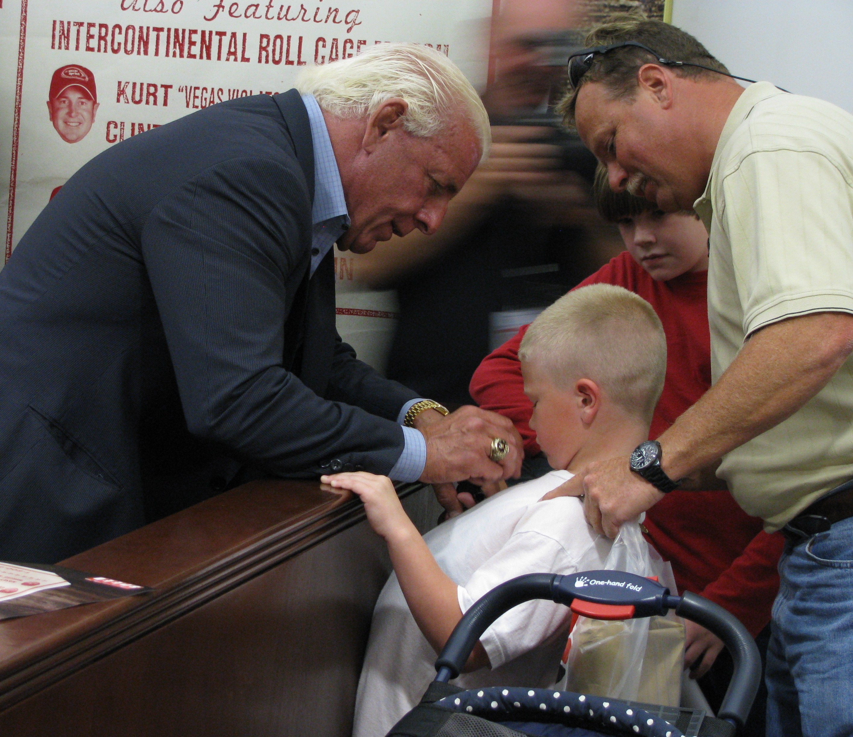 Ric Flair signing the shirt of a Special Needs Child