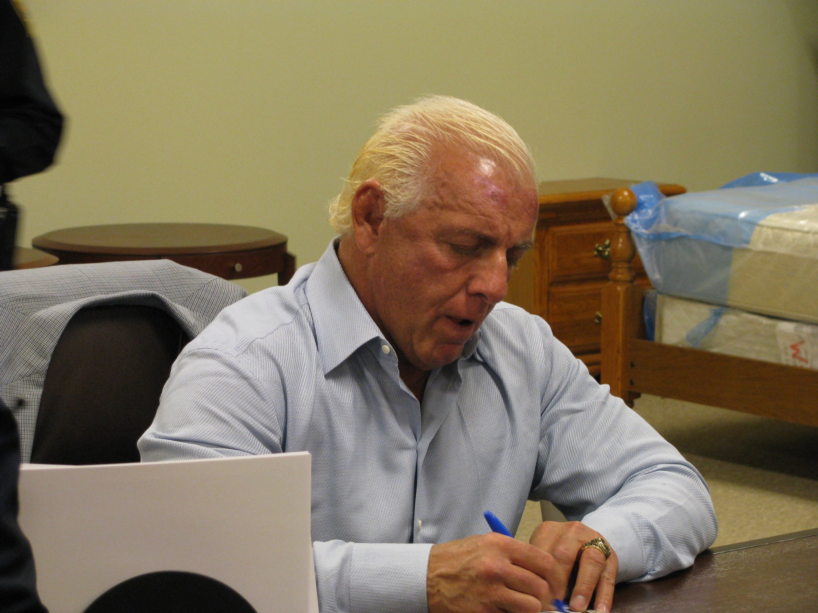 Ric Flair is signing a lot of autographs these days