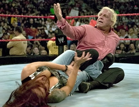 Ric Flair With The Figure 4 Leg Lock On Lita
