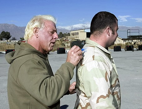 Ric Flair Signs a Autograph for a soldier