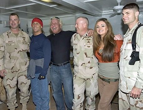 Ric Flair,Shawn Michaels and Maria with some Soldiers