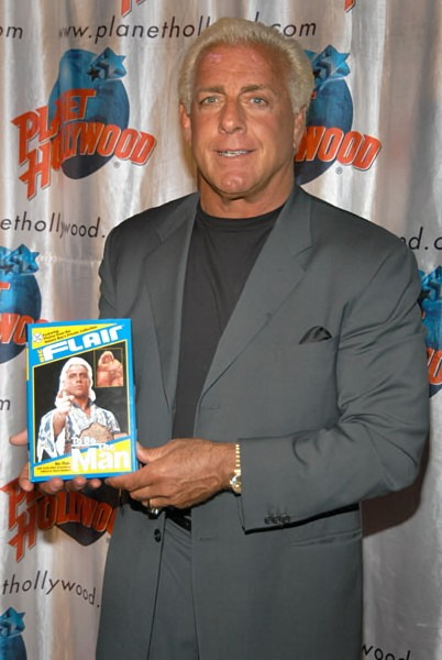 Ric Flair with a Copy of the Best Book Ever Written By a Wrestler