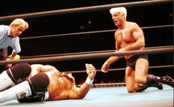Ric Flair beating up Hulk Hogan some more