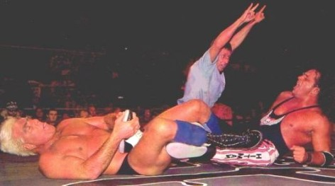 Ric Flair has Bret Hart in the Figure four Leglock