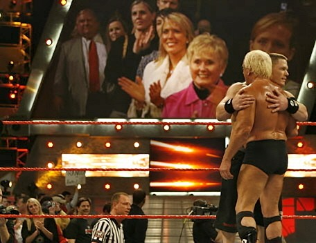 Ric Flair and John Cena Embrace as Flair's Family Looks On.