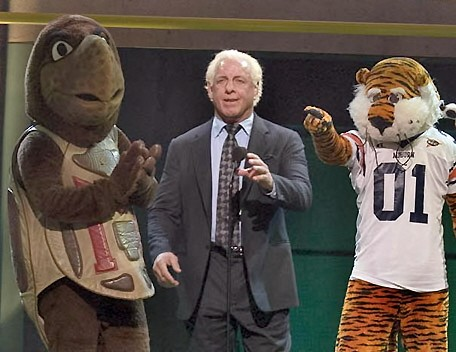 Ric Flair with a Couple Mascots